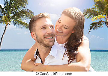 Happy Couple Having Fun At Beach