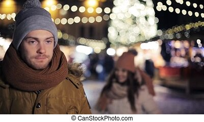 happy couple having fun at christmas market - love, winter...
