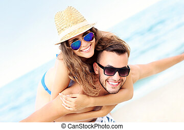 Happy couple having fun at the beach