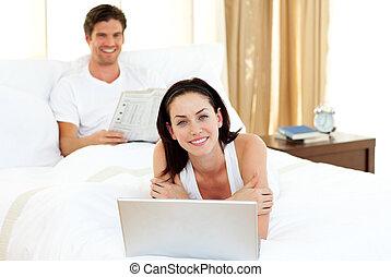Happy couple having fun in the bedroom