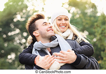 Happy couple having fun on a date in the park