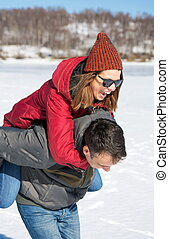 Happy couple having fun on a frozen lake