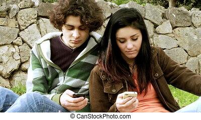 Happy couple having fun texting