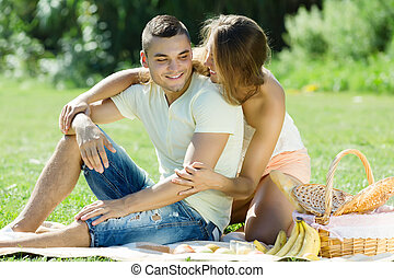 Happy   couple having picnic