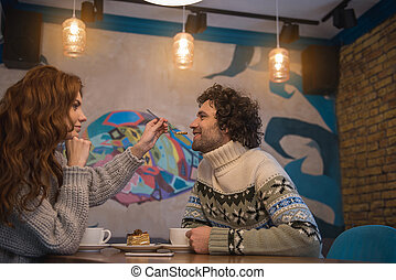 Happy couple having romantic date in cafe