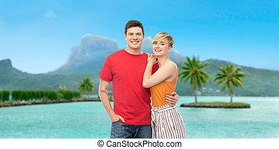 happy couple hugging over bora bora beach