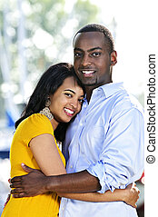 Happy couple hugging - Young romantic couple hugging and...