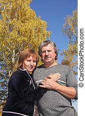 Happy couple in autumn park 2