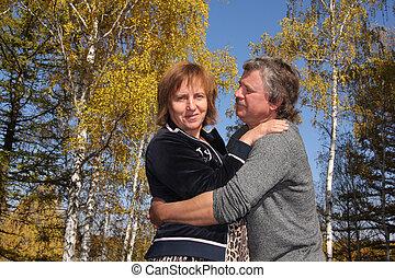 Happy couple in autumn park 3