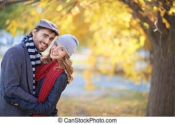 Happy couple in autumn - Portrait of a young couple in...