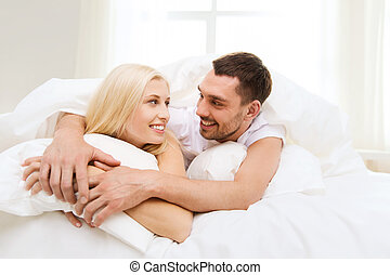 happy couple in bed at home