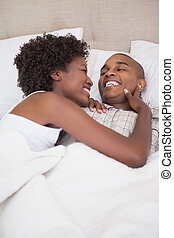 Happy couple in bed together