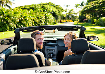 Happy couple in car on summer road trip travel