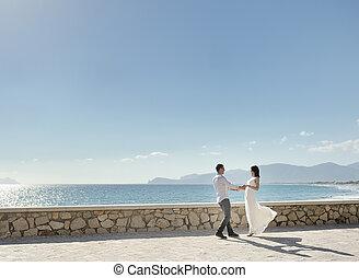 happy couple in honeymoon near sea in Italy