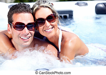 Happy couple in jacuzzi.