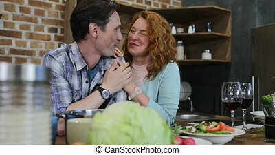 Happy Couple In Kitchen Man And Woman Embracing Looking At Each Other At Home