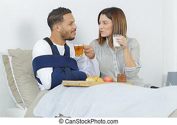 happy couple in love having breakfast in bed