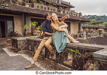 Happy couple in love in abandoned and mysterious hotel in ...