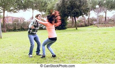 Happy couple in love jumping huggin