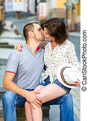 Happy couple in love kissing at city