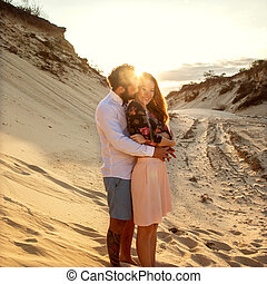 happy couple in love on the sand dunes, concept of Valentine's Day