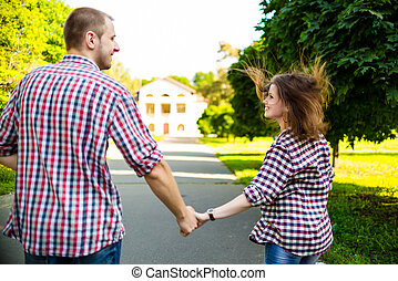 Happy couple in love running at alley