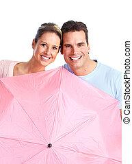 Happy couple in love under umbrella.