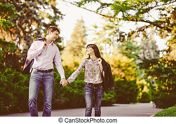 Happy couple in love walking at alley