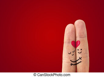? happy couple in love with painted smiley and hugging