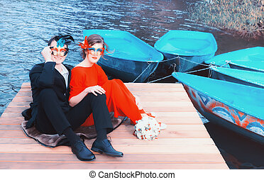 Happy Couple In Masquerade Masks