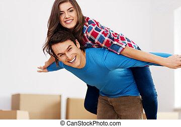 Happy couple in new apartment