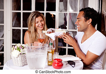 Happy Couple in Outdoor Cafe