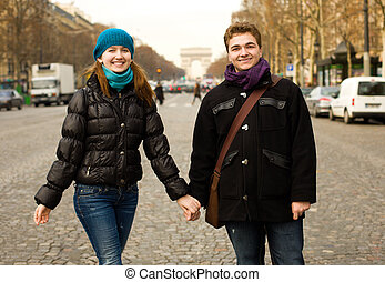 Happy couple in Paris on the Champs Elysees