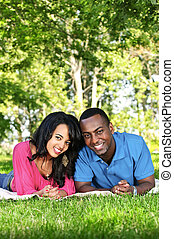Happy couple in park - Young romantic couple enjoying summer...