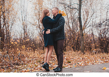 Happy couple in the autumn park