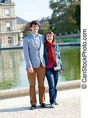 Happy couple in the Luxembourg garden in Paris