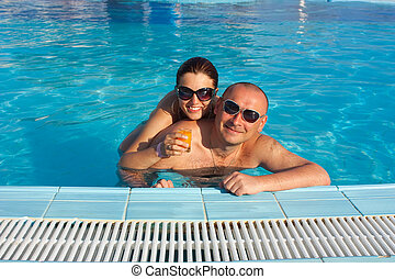 happy couple in the swimming pool