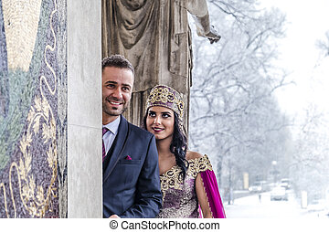 Happy couple in traditional turkish wedding dress during ...