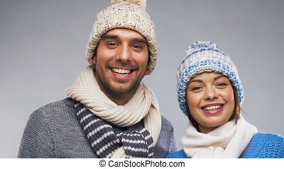 happy couple in winter clothes - people, christmas and...