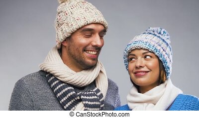 happy couple in winter wear looking at each other - people,...