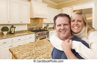Happy Couple Inside Beautiful Custom Kitchen