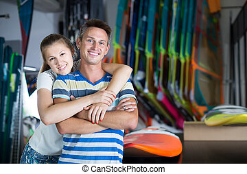 Happy couple is choosing colorful boards