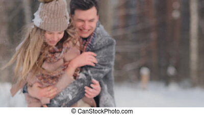 Happy Couple is Playing Winter Game Outside Enjoying...