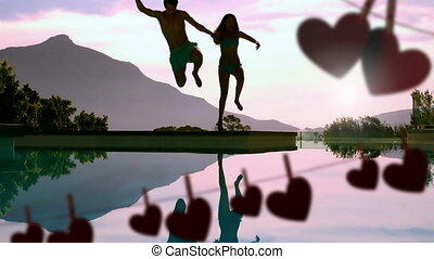 Happy couple jumping in a lake and hearts for valentine day