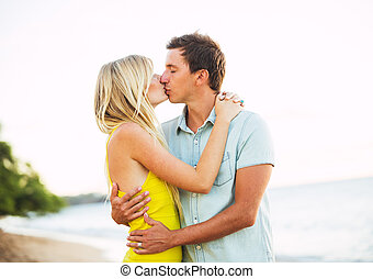 Couple Kissing on the Beach at Sunset