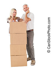 Happy couple leaning on pile