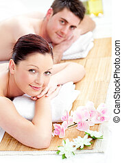 happy couple lying on a table