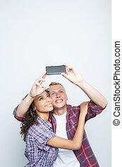 Happy couple making photos