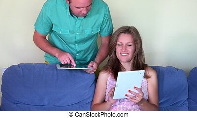 Happy couple man help his woman with tablet computer. closeup