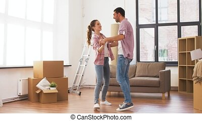 happy couple moving to new home and dancing - accommodation,...